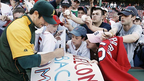 Nomar signing for fans.
